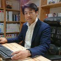 「我流の経営論に限界を感じ、HBMSで学んでみようと思った」と話す前田政登己さん=中区のマエダハウジングで、元田禎撮影