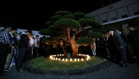 Atsuma Town Government officials offer a silent prayer at 3:07 a.m. on Sept. 6, 2019, the first anniversary of a powerful earthquake that struck Hokkaido and claimed 44 lives. (Mainichi/Taichi Kaizuka)