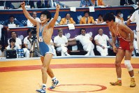1988 Seoul Olympics -- Japan's Mitsuru Sato wins the gold medal in the 52-kilogram division of the men's freestyle wrestling.