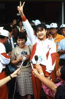 1988 Seoul Olympics -- Japan's Tomoko Hasegawa is seen after securing silver medal in the women's 25-meter pistol shooting event to become the first Japanese medalist in the games.