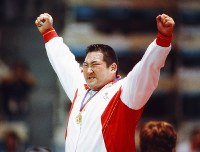 1988 Seoul Olympics -- Japan's Hitoshi Saito raises his arms after winning the gold medal in the over-95-kilogram division in the men's judo.