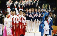 1988 Seoul Olympics -- The Japanese men's gymnastics team captures the bronze medal in the team event after Daisuke Nishikawa and Koichi Mizushima scored perfect 10s in the pommel horse.