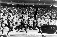 1988 Seoul Olympics -- Ben Johnson, of Canada, crosses the finish line in first place in the men's 100 meters while Carl Lewis, of the United States, follows in second. Johnson was later stripped of the gold medal for doping.