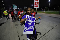United Auto Workers members picket outside the General Motors Detroit-Hamtramck assembly plant in Hamtramck, Mich., on Sept. 16, 2019. (AP Photo/Paul Sancya)