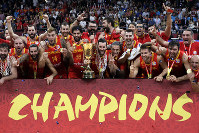 Members of Spain's team celebrate with the Naismith Trophy after they beat Argentina in their first-place match in the FIBA Basketball World Cup at the Cadillac Arena in Beijing, on Sept. 15, 2019. (AP Photo/Mark Schiefelbein)