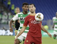 Roma's Henrikh Mkhitaryan, front, controls the ball during a Serie A soccer match between Roma and Sassuolo, in Rome, on Sept. 15, 2019. (AP Photo/Gregorio Borgia)