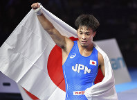 Shinobu Ota of Japan celebrates after winning the gold match of the men's Greco-Roman 63kg category against Stepan Maryanyan of Russia during the Wrestling World Championships in Nur-Sultan, Kazakhstan, on Sept. 15, 2019. (AP Photo/Anvar Ilyasov)