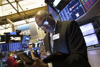 John Wilson, with the New York Stock Exchange, monitors stock activity, on Sept. 16, 2019. (AP Photo/Mark Lennihan)