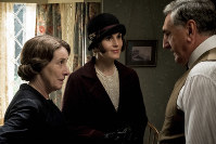 This image released by Focus Features shows, from left, Phyllis Logan as Mrs. Hughes, Michelle Dockery as Lady Mary Talbot and Jim Carter as Mr. Carson in