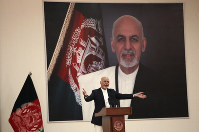 In this Sept. 9, 2019 file photo, Afghan President Ashraf Ghani speaks during a ceremony to introduce the new chief of the intelligence service, in Kabul, Afghanistan. (AP Photo/Rahmat Gul)
