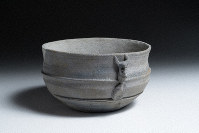 The pot found at the Takadono 7 Chome remains site is seen with a decoration depicting what appears to be a human face with horns sprouting from it, in this image provided by the Osaka City Cultural Properties Association.