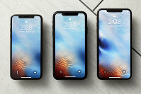 This Oct. 22, 2018, file photo shows the iPhone XS, from left, iPhone XR, and the iPhone XS Max in New York. (AP Photo/Richard Drew)