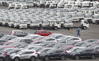 In this July 8, 2019 photo, Honda cars for export, foreground, park at Yokohama port in Kanagawa Prefecture. (AP Photo/Koji Sasahara)