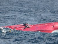 Divers from the Japan Coast Guard are seen searching for the missing crew members of a capsized Japanese fishing boat, off Hokkaido, northern Japan. (Photo courtesy of Japan Coast Guard/Mainichi)