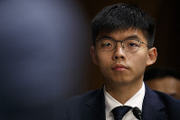 Hong Kong activist Joshua Wong, listens during a congressional hearing on the Hong Kong protests, on Sept. 17, 2019, on Capitol Hill in Washington. (AP Photo/Jacquelyn Martin)