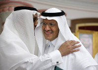 Energy Minister Prince Abdulaziz bin Salman smiles as he is congratulated after a press conference in Jiddah, Saudi Arabia, on Sept. 17, 2019. AP Photo/Amr Nabil)