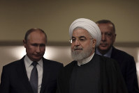 Turkish President Recep Tayyip Erdogan, right, Russia's President Vladimir Putin, left, and Iran's President Hassan Rouhani arrive for a news conference in Ankara, Turkey, on Sept. 16, 2019. (AP Photo/Burhan Ozbilici)