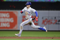 Toronto Blue Jays' Cavan Biggio heads to second with a double off Baltimore Orioles pitcher Shawn Armstrong during the eighth inning of a baseball game on Sept. 17, 2019, in Baltimore. The Blue Jays won 8-5. (AP Photo/Julio Cortez)