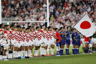 In this Sept. 6, 2019 file photo, Japan players line up on the field during the national anthem ahead of their rugby match against South Africa at Kumagaya Rugby Stadium in Saitama, Japan. (AP Photo/Shuji Kajiyama)
