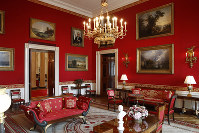 This Sept. 17, 2019, photo shows refreshed wall fabric in the Red Room of the White House in Washington. (AP Photo/Patrick Semansky)