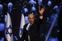 Israeli Prime Minister Benjamin Netanyahu addressees his supporters at party headquarters after elections in Tel Aviv, Israel, on Sept. 18, 2019. (AP Photo/Ariel Schalit)