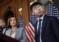 U.S. House Speaker Nancy Pelosi, left, is seen with Hong Kong activist Joshua Wong and other members of Congress during a news conference on human rights in Hong Kong, on Capitol Hill in Washington, on Sept. 18, 2019. (AP Photo/Pablo Martinez Monsivais)