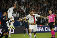 PSG's Angel Di Maria celebrates after scoring his side's second goal during the Champions League group A soccer match between PSG and Real Madrid at the Parc des Princes stadium in Paris, on Sept. 18, 2019. (AP Photo/Francois Mori)
