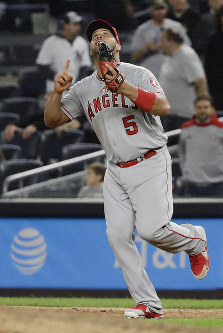 Los Angeles Angels first baseman Albert Pujols celebrates after the Angels' 3-2 win in a baseball game against the New York Yankees on Sept. 18, 2019, in New York. (AP Photo/Frank Franklin II)