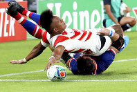 Japan's Kotaro Matsushima, top, makes an attempt to score a try, as he is tackled by Russia's Vasily Artemyev, during the Rugby World Cup Pool A game at Tokyo Stadium between Russia and Japan in Tokyo, Japan, on Friday, Sept. 20, 2019. The try was disallowed by video referee. (AP Photo/Eugene Hoshiko)