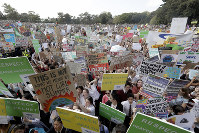 Thousands of protestors, many of them school students, gather in Sydney, on Sept. 20, 2019, calling for action to guard against climate change. (AP Photo/Rick Rycroft)