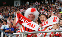 Japanese fans cheer for Japan during the opener of the Rugby World Cup between Japan and Russia at Tokyo Stadium (Ajinomoto Stadium) on Sept. 20, 2019. (Mainichi/Naoaki Hasegawa)
