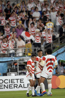 The Japanese team members celebrate after Kotaro Matsushima, center, scored a try against Russia in the first half of the opener of the Rugby World Cup at Tokyo Stadium (Ajinomoto Stadium) on Sept. 20, 2019. (Mainichi/Tatsuya Fujii)