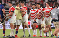 The Japanese players greet their Russian opponents after their victory in the opener of the Rugby World Cup at Tokyo Stadium (Ajinomoto Stadium) on Sept. 20, 2019. (Mainichi/Yuki Miyatake)