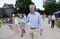 In this July 4, 2019, file photo, Democratic presidential candidate New York Mayor Bill de Blasio walks in the Independence Fourth of July parade in Independence, Iowa. (AP Photo/Charlie Neibergall)