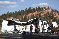 Authorities work the scene where at least four people were killed in a tour bus crash near Bryce Canyon National Park, on Sept. 20, 2019, in Utah. (Spenser Heaps/The Deseret News via AP)