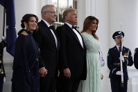 President Donald Trump and first lady Melania Trump welcome Australian Prime Minister Scott Morrison and his wife Jenny Morrison during for a state dinner at the White House, on Sept. 20, 2019, in Washington. (AP Photo/Evan Vucci)