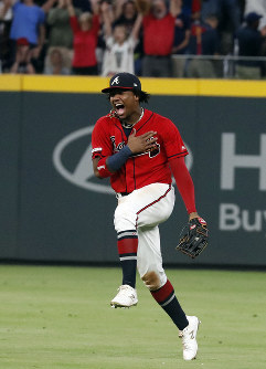 Atlanta Braves center fielder Ronald Acuna Jr. reacts after defeating the San Francisco Giants 6-0 in a baseball game to clinch the NL east baseball title on Sept. 20, 2019, in Atlanta. (AP Photo/John Bazemore)