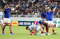 French players celebrate after teammate Camille Lopez kicked a drop goal during the Rugby World Cup Pool C game at Tokyo Stadium between France and Argentina in Tokyo, Japan, on Saturday, Sept. 21, 2019. (AP Photo/Eugene Hoshiko)