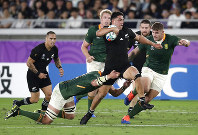 New Zealand's Anton Lienert-Brown makes a break during the Rugby World Cup Pool B game at International Stadium between New Zealand and South Africa in Yokohama, Japan, Saturday, Sept. 21, 2019. (AP Photo/Jae Hong)