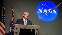 Australian Prime Minister Scott Morrison delivers remarks prior the signing of a letter of intent between NASA and the Australian Space Agency, on Saturday, Sept. 21, 2019 at NASA Headquarters in Washington. NASA and the Australian Space Agency will build on over 60 years of collaboration in space exploration between the two countries and commit to expanding cooperation. (Joel Kowsky via AP)