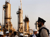 During a trip organized by Saudi information ministry, a security guarder stands alert in front of Aramco's oil processing facility after the recent Sept. 14 attack on Aramco's oil processing facility in Abqaiq, near Dammam in the Kingdom's Eastern Province, on Friday, Sept. 20, 2019. (AP Photo/Amr Nabil)