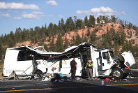 Authorities work the scene where at least four people were killed in a tour bus crash near Bryce Canyon National Park, on Friday, Sept. 20, 2019, in Utah. (Spenser Heaps/The Deseret News via AP)
