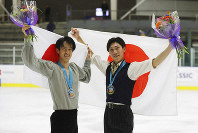First-place finisher Keiji Tanaka, right, celebrates with second-place Sota Yamamoto, left, both of Japan, following the men's competition at the U.S. International Figure Skating Classic on Friday, Sept. 20, 2019, in Salt Lake City. (AP Photo/Rick Bowmer)