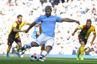 Manchester City's Sergio Aguero scores his side's second goal from a penalty spot during the English Premier League soccer match between Manchester City and Watford at Etihad stadium in Manchester, England, on Saturday, Sept. 21, 2019. (AP Photo/Rui Vieira)