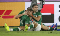 Ireland's Conor Murray, right, congratulates teammate Andrew Conway after he scored their fourth try during the Rugby World Cup Pool A game at International Stadium between Ireland and Scotland in Yokohama, Japan, on Sunday, Sept. 22, 2019. (AP Photo/Jae Hong)