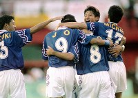 1996 Atlanta Olympics -- Members of the Japanese men's soccer team celebrate the opening goal by Teruyoshi Ito in the 27th minute of the second half of their group stage match against Brazil. (Mainichi/Yukihisa Hirano)