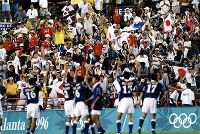 1996 Atlanta Olympics -- The Japanese men's soccer team celebrates after finishing their match against Brazil without conceding a goal. Goalkeeper Yoshikatsu Kawaguchi defended well. Japan was also lucky as shots by Brazil had hit the posts and missed. (Mainichi/Yukihisa Hirano)