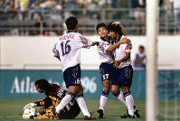 1996 Atlanta Olympics -- Masakiyo Maezono, right, of the Japanese men's soccer team, celebrates after earning a penalty kick against Hungary. The team won their group stage match but failed to advance to the knockout round due to goal differential. (Mainichi/Yasunori Sato)