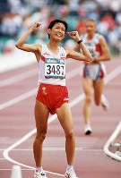 1996 Atlanta Olympics -- Japan's Yuko Arimori, who took the bronze medal in the women's marathon, raises her fists in celebration. It followed her silver medal at the previous Olympic Games. She shed tears and said after the competition,