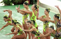 1996 Atlanta Olympics -- The Japanese synchronized swimming team give a ninja-themed performance in the technical routine to place third, narrowly behind second-placed Canada. The team held onto its position in the free routine and took the bronze medal. (Mainichi/Yukihisa Hirano)